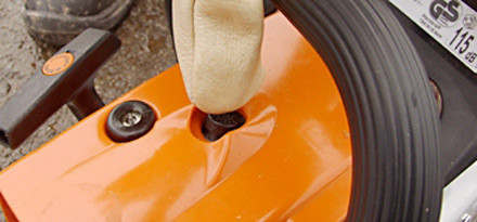 Step 3 of 15: If your chain saw is fitted with a decompression valve, press it now. It assists with firing the engine and starting your chain saw.