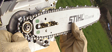 Chain side tensioning in 15 easy steps stihl stihl step 7 of 15 now pick up the chain and guide bar assembly and route keyboard keysfo Choice Image